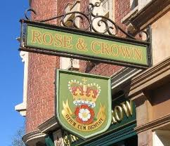 A modern pub sign in the name of the Rose and Crown