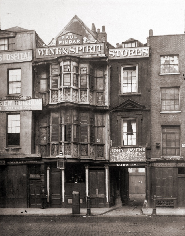 "The ""Paul Pindar's Head Tavern"" in Bishopsgate Street, London, c.1890. Note the signed entrance to Half Moon Street (i.e. originally Half Moon Alley) on the right hand side of the house front."