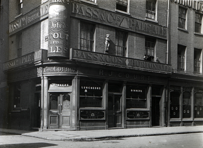 The Fortune of War Public House at the corner of Cock Lane and Guiltspur Street prior to it demolition in 1910 - Note the position of the Golden Boy of Pye Corner statue in its upper wall