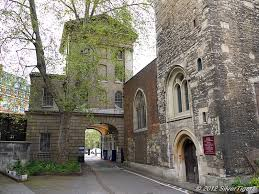 The rear of St. Bartholomew Hospital's King Henry VIII Gate showing the west end entrance to the parish church of St. Bartholemew the Less