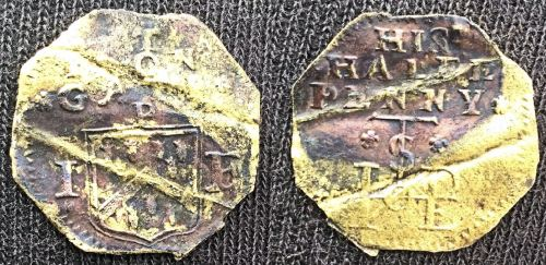 "A half penny tradesman's token issued by John and Elizabeth Patston at the Iron Gate adjacent to the Tower of London. This example was found by a ""mudlark"" on the foreshore of the River Thames."